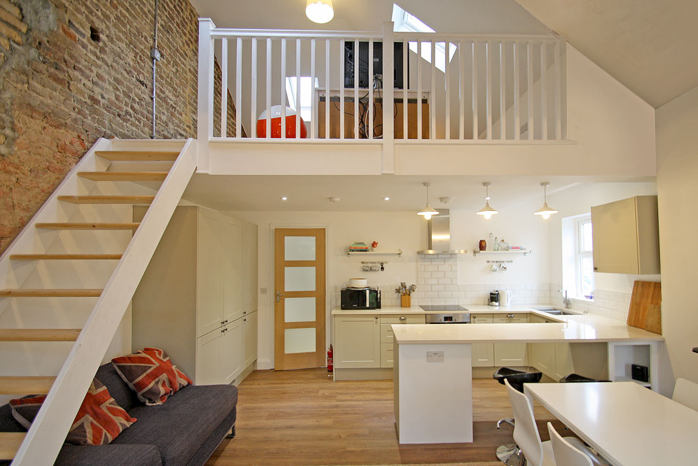 View in gallery Ergonomic kitchen tucked neatly under the Mezzanine floor